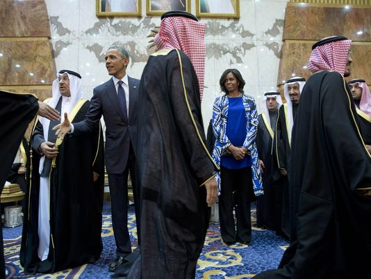 President Obama and first lady Michelle Obama participate in a delegation receiving line with new Saudi King Salman bin Abdul Aziz, fith left, in Riyadh, Saudi Arabia. The president and first lady have come to expresses their condolences on the death of the late Saudi Arabian king Abdullah bin Abdulaziz al-Saud. (AP Photo/Carolyn Kaster)